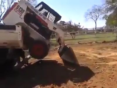 Skid-steer loader loaded on the truck with skill - DrivingOnly.com