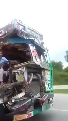Smashed truck still being driven on the road
