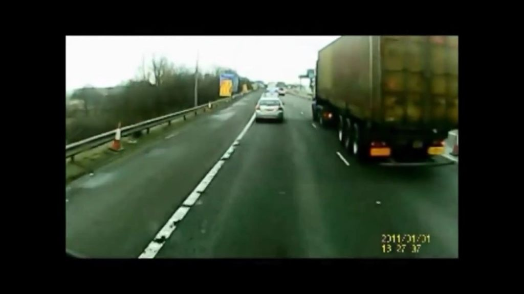 Lorry changing lanes pushes a car off the road