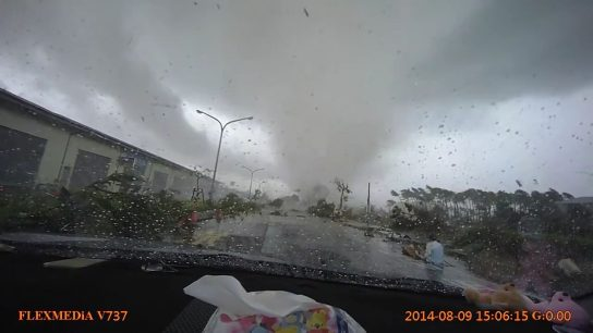 A car gets sucked in by the tornado