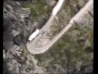 Lorry travelling through tiny roads on mountains
