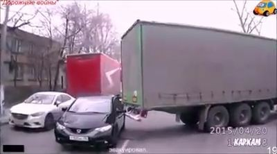 Lorry accidentally hooks the car and drags it