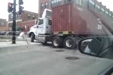 Trucker fails turning into the road (Video)