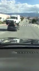 Car transporting another car on its roof (Video)