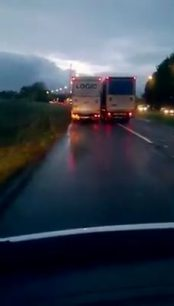 Two lorries fighting for a space on lane (Video)