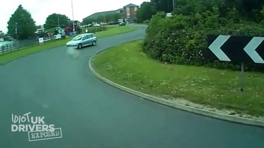 Car driver driving on a wrong roundabout side (Video)